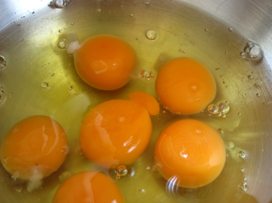 six eggs cracked into a bowl
