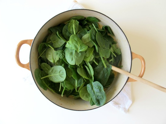 Stirring Spinach into Thai Butternut Squash Coconut Noodle Soup
